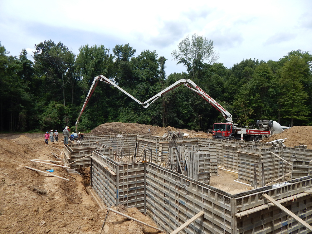 foundation walls being set in place