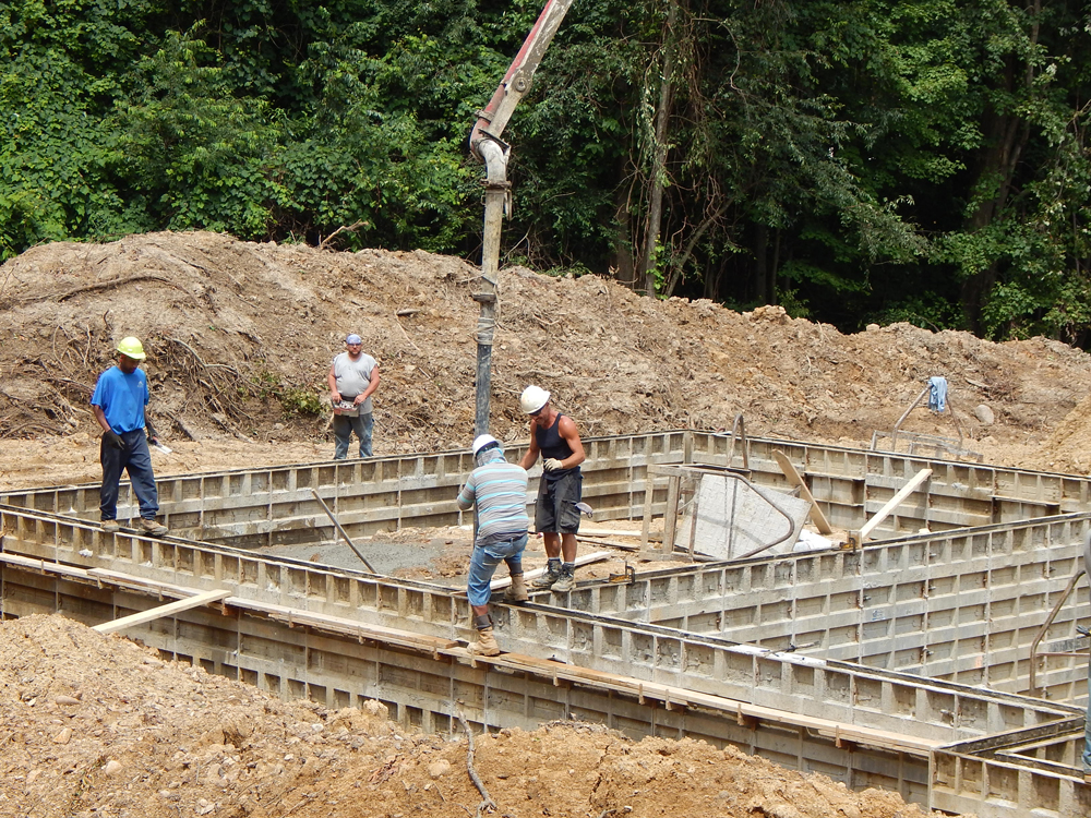workers pouring the foundation