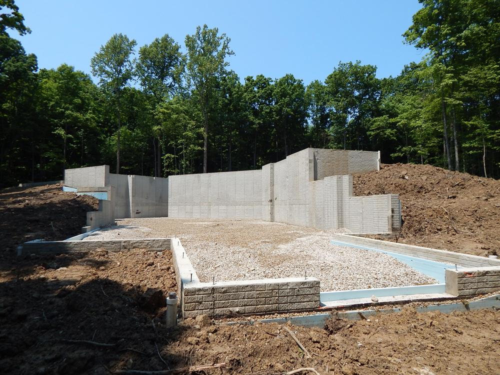 view of home foundation from the ground